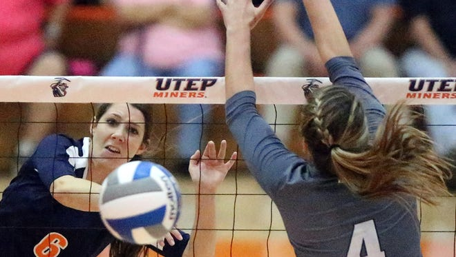 UTEP'S Tatum Winter, 6, fires a shot past Leah Mikesky, 4, of Rice during their match Sunday in Memorial Gym on the UTEP campus.