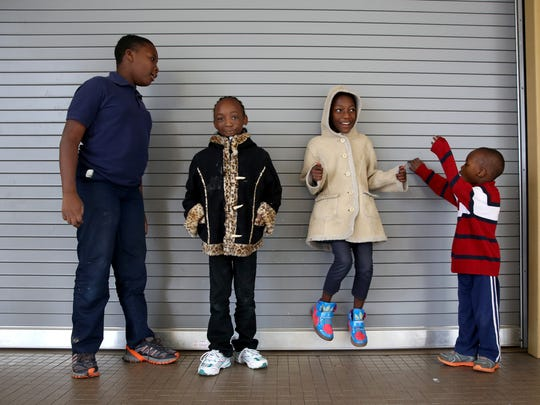 Moustapha Drame, 10, far left, plays with his siblings