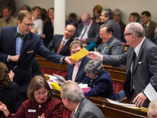 Rep. Ben Joseph, D-North Hero, right, hands his ballot to Rep. Martin Lalonde, D-South Burlington, as the House votes for Speaker of the House on the opening day of the Legislature at the Statehouse in Montpelier on Wednesday, January 4, 2017
