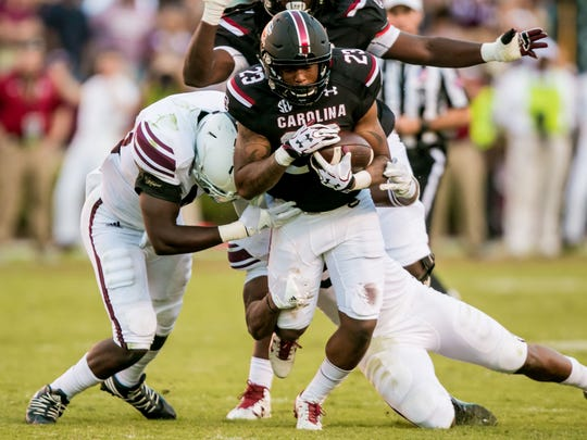 Oct 1, 2016; Columbia, SC, USA;  South Carolina Gamecocks running back Rico Dowdle (23) rushes against the Texas A&M Aggies in the second half at Williams-Brice Stadium. Mandatory Credit: Jeff Blake-USA TODAY Sports