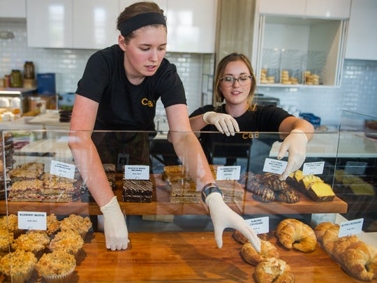 Audrey McKnight, left, and Lindsey McKnight swap out the breakfast pastries for the all-day pastries at Caviar & Bananas on Monday, June 19, 2017.