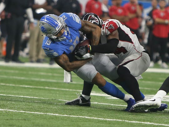 Lions WR Kenny Golladay makes a catch against the Falcons'