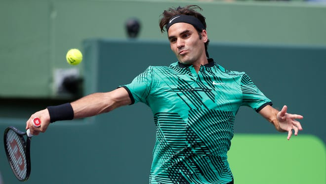 Roger Federer, of Switzerland, returns a shot from Juan Martin del Potro, of Argentina, during their match at the Miami Open.