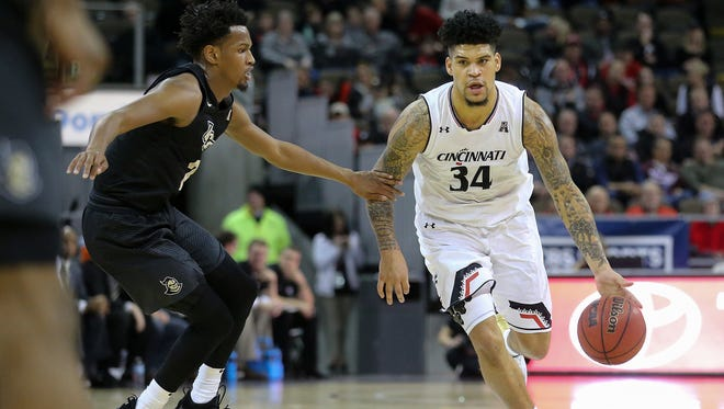 Cincinnati Bearcats guard Jarron Cumberland (34) dribbles around the 3-point line in the second half during the NCAA basketball game between the UCF Knights and the Cincinnati Bearcats, Tuesday, Feb. 6, 2018, at BB&T Arena in Highland Heights, Ky. Cincinnati won 77-40.