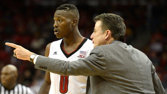 Nov 21, 2014; Louisville, KY, USA; Louisville Cardinals head coach Rick Pitino talks with guard Terry Rozier (0) during the second half against the Marshall Thundering Herd at KFC Yum! Center. Louisville defeated Marshall 85-67. Mandatory Credit: Jamie Rhodes-USA TODAY Sports