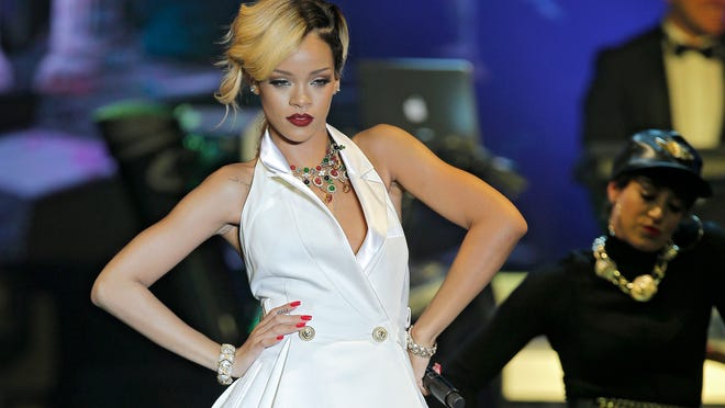 "FILE - In this July 10, 2013 file photo, singer, songwriter Rihanna performs at ""Le Sporting"" in Monaco during her ""Diamonds World Tour"". The Council of Fashion Designers of America, Inc. announced Monday, March 24, 2014, that the 26-year-old pop star will receive at the CFDA Fashion Icon Award on June 2 in New York City. (AP Photo/Lionel Cironneau, File)"