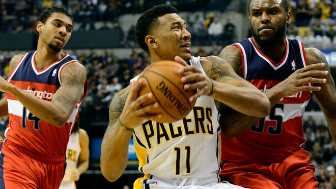 Nov 29, 2013; Indianapolis, IN, USA; Indiana Pacers shooting guard Orlando Johnson (11) makes a drive towards the basket against Washington Wizards power forward Trevor Booker (35) during the second half of the game at Bankers Life Fieldhouse. Indiana Pacers win 93 to 73. Mandatory Credit: Marc Lebryk-USA TODAY Sports