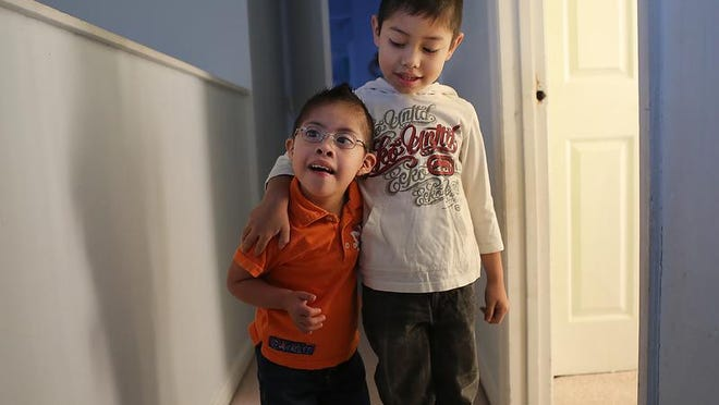 Lawrence Gonzalez, left, hangs out with  with his brother, Oscar,  at their Hamilton home.