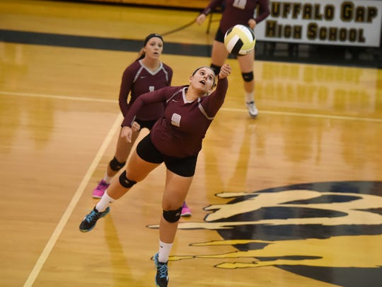 Stuarts Draft's Abigail Foster lunges to make a return during their volleyball game against Buffalo Gap on Tuesday, Sept. 22, 2015.