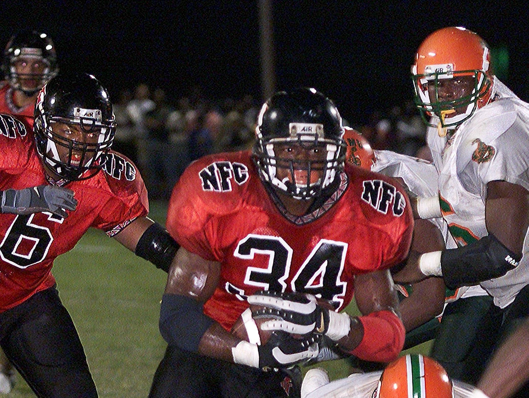 North Florida Christian's Ernie Sims runs towards the endzone against FAMU High on Oct. 12, 2001.
