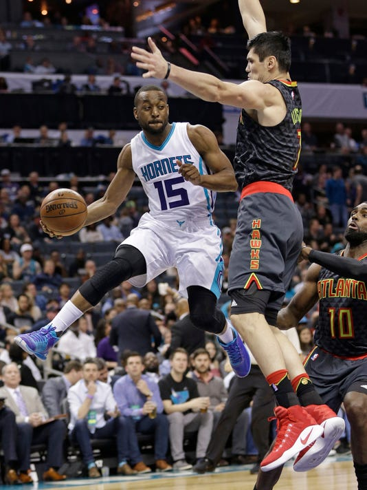 Charlotte Hornets' Kemba Walker (15) drives past Atlanta Hawks' Ersan Ilyasova (7) during the second half of an NBA basketball game in Charlotte, N.C., Monday, March 20, 2017. The Hornets won 105-90. (AP Photo/Chuck Burton)