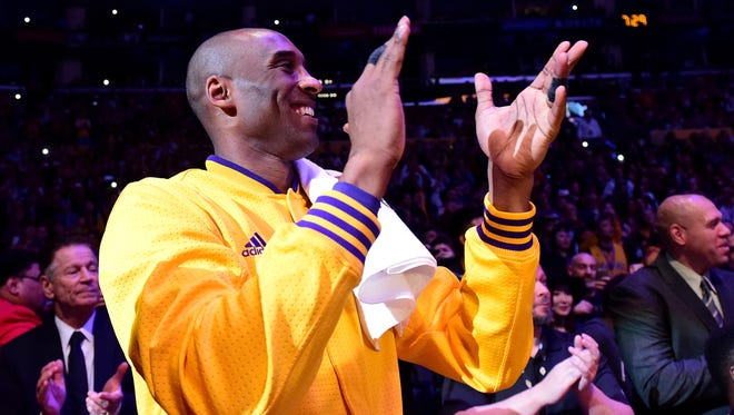 Kobe Bryant of the Los Angeles Lakers smiles and claps before his final game ever.