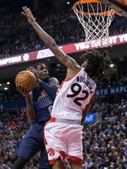 Mavericks guard Manny Harris shoots on Raptors center
