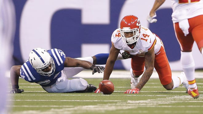 Indianapolis Colts running back Josh Ferguson (34) muff the punt return fumbling the ball then fights to get it back with Kansas City Chiefs Demarcus Robinson (14) in the first half of their game Sunday, October 30, 2016, afternoon at Lucas Oil Stadium.
