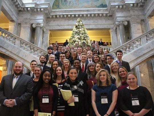52 Henderson County students pictured at the Kentucky State Capitol on day two of the Kentucky Youth Assembly conference. Delegates debated bills in both the House and Senate chambers.