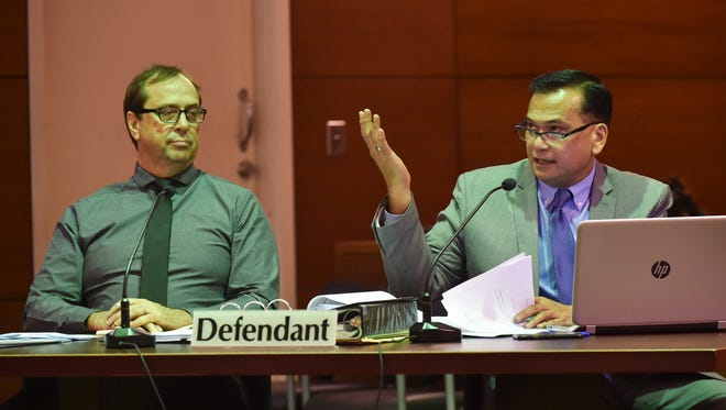 """University of Guam professor Michael B. Ehlert, left, listens as his defense attorney Joaquin """"Jay"""" Arriola, cross examines an accuser during his client's sexual assault trial at the Superior Court of Guam on July 18, 2017."""