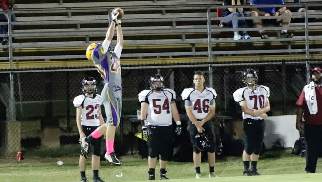 Steven Jaciuk intercepts a Lawrence County pass that would eventually lead to a Purvis touchdown.