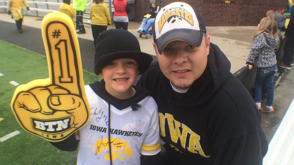 Cale Morrow, 8, and Scott Morrow of Martensdale.