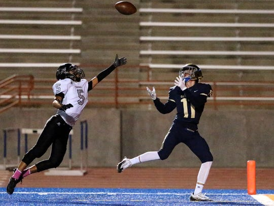 Cathedral wide receiver Nathan Aguilar, 11, catches