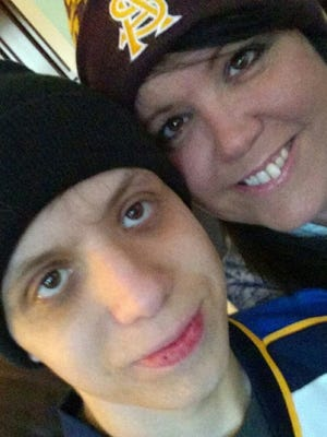 Josh and his mom Melanie Knight ahead of a hockey game.