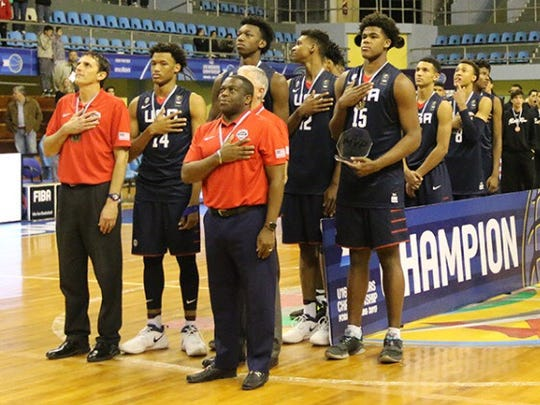 Sanford coach Stan Waterman (front right, in red) listens to the national anthem after helping coach the USA Basketball team to the gold medal in the FIBA Americas U16 tournament last July in Formosa, Argentina.