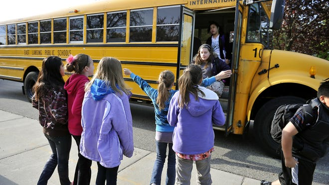 An East Lansing Public Schools bus drops off children last spring at Whitehills Elementary school in this LSJ file photo.