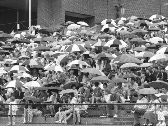 Spectators kept their umbrellas up at Ty Cobb Stadium until the rain let up just before the BC Pops began their performance at Union-Endicott High School in 1996.