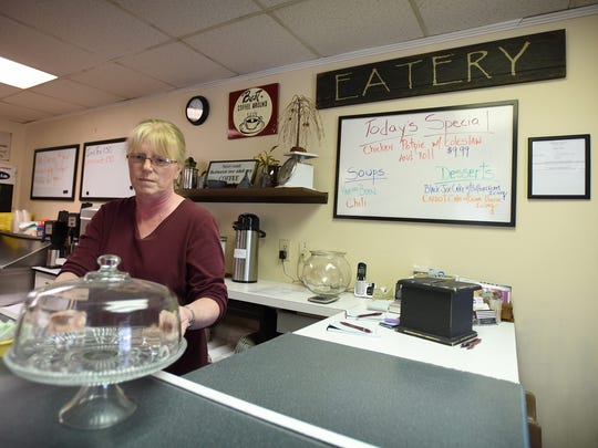 Owner Denise Fisher stands behind the counter at the Olde Willow Tree Cafe at 20 N. College St., Myerstown, on Tuesday, April 19, 2016. The cafe opened for business on Wednesday, April 20, in the space once occupied by the Kold Duck Kafe.