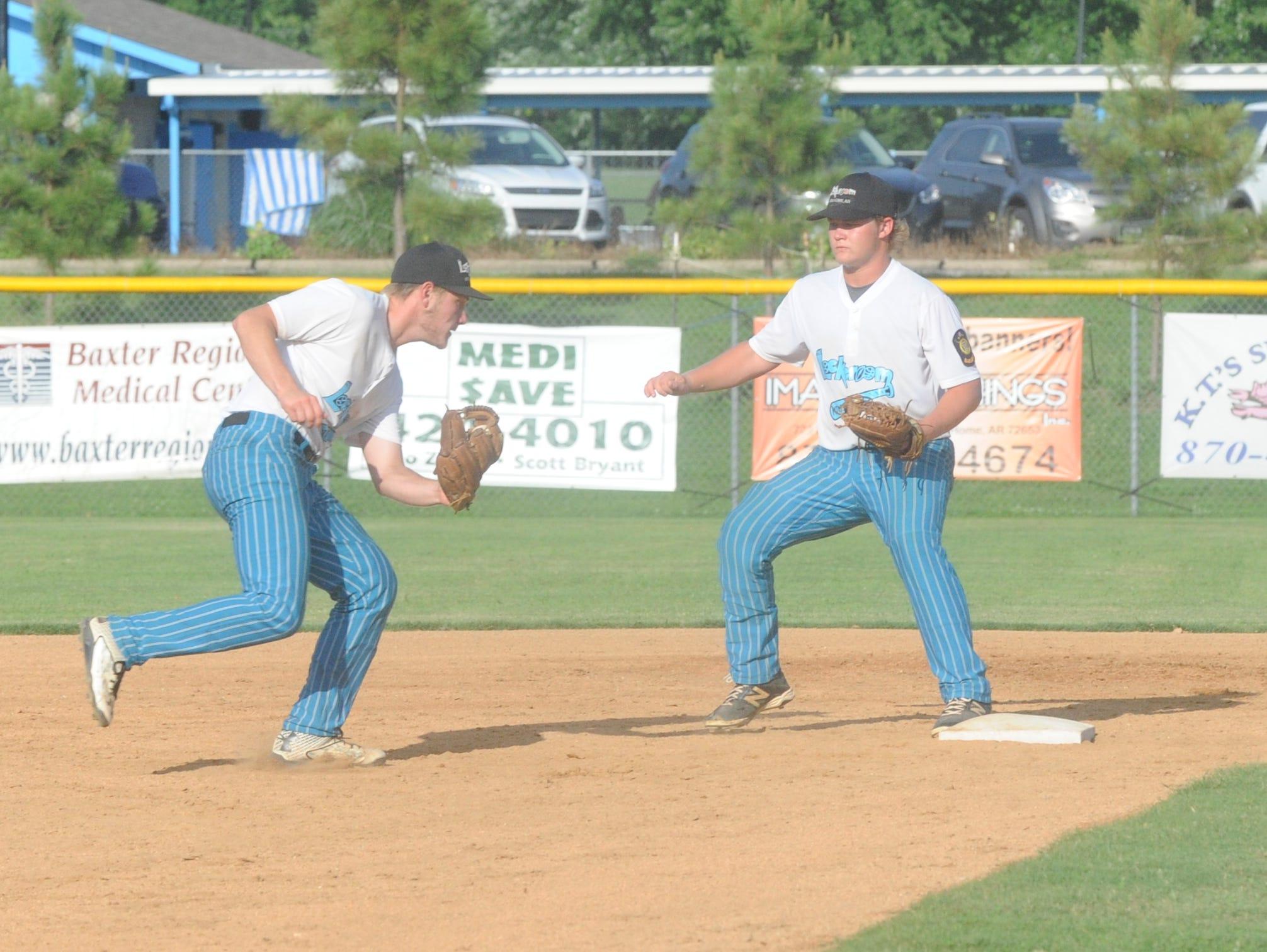 Lockeroom shortstop Hayden Hall and second baseman Matt Robbins converge on a ground ball during Mountain Home's 8-0 loss to Jonesboro on Saturday. Lockeroom also fell to Jonesboro, 6-4, on Friday night at Jonesboro.
