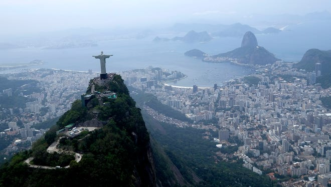 The Christ the Redeemer statue is shown in this aerial view of Rio de Janeiro.