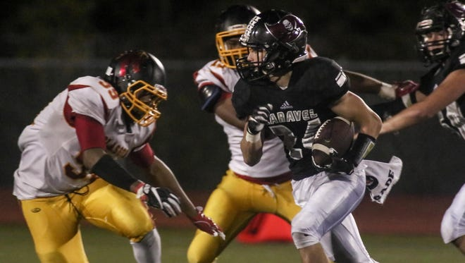 Caravel Academy running back Ethan Potter (24) rushes for a 6 years in the fourth quarter of a week nine DIAA game between Caravel and Glasgow, Friday, Nov. 03, 2017 at Caravel Academy in Bear, DE.