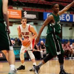 Fox Lane's Matt Redhead (20) in action at the Slam Dunk Tournament consolation game against Harborfields at the Westchester County Center on Tuesday, Dec. 29, 2015.