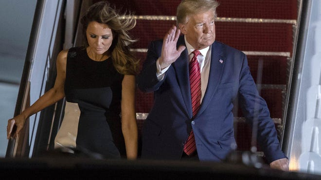 President Donald Trump and First Lady Melania Trump arrive at Palm Beach International Airport in West Palm Beach, Friday, Feb. 14, 2020.