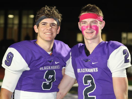 Bloomfield Hills wide receiver Ty Slazinski (right) set a state record Friday for single-game receptions from quarterback John Paddock.