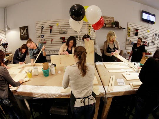 An overall of a workshop at Board and Brush Creative Studio Thursday April 28, 2016 in Sheboygan.