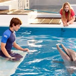 Sawyer (Nathan Gamble) and Hazel (Cozi Zuehlsdorff) chat with Winter the dolphin.