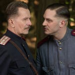 """Gary Oldman and Tom Hardy are police officers in Stalinist Russia in """"Child 44."""" You can tell this is an on-set photo and not an actual still from the movie because it doesn't look like mud."""