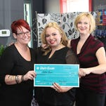 Middlesex resident Melanie Dare (center), owner of Salon Dare in Hillsborough, with co-workers Erin Hughes-Defilippi (left) and Cara Localio, celebrating the $10,000 grand prize in Unity Bank's Small Business Dreams BIG Contest.