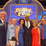 """The five contestants with host Steve Harvey are Charles """"Chuck"""" Beams, Karla Beams Taylor and Jason Taylor, all of Sumner County, and Terry and Kathy Lawson of Campbellsville, Ky."""