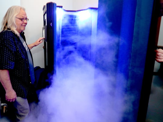 Owner Mark Chesshir shows the cold fog floating out of the Whole Body Cryotherapy chamber at Float Alchemy.