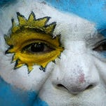 An Argentina fan waits for the 2014 World Cup Group F soccer match between Argentina and Iran at the the Mineirao stadium in Belo Horizonte June 21.
