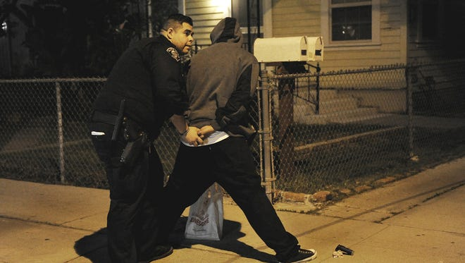 Chris Rivera, a second-year police officer, searches a man in east Santa Paula on March 10. The man, who was on parole, was taken into custody on suspicion of possessing drugs and paraphernalia.