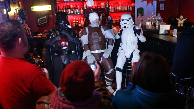 "Darth Vader, bounty hunter Dengar and a Stormtrooper attract cameras at Oddity Bar in Wilmington for a ""Star Wars""-themed bingo night Wednesday."