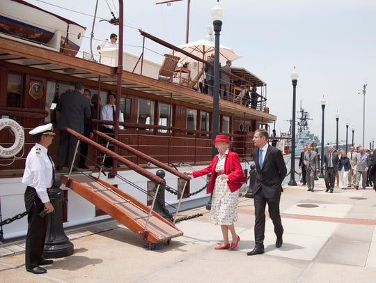 Danish Queen Margrethe walks with Vestas CEO Ditlev