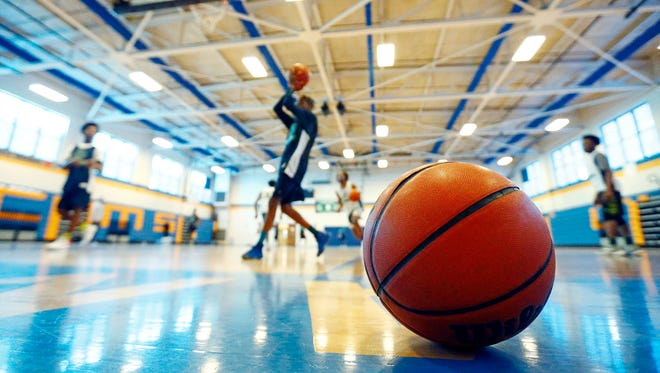 A basketball sits  as LEAD Academy players practice in the background, Wednesday, Jan. 31, 2018, in Nashville, Tenn. (Photo by Wade Payne, Special to the Tennessean)