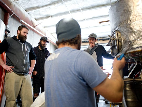 Brian Eckert, owner and head brewer of Four Quarters Brewing in Winooski, explains the process to Monkey House bar owner Ryan Smith and his employees, Wren Kitz and Isaiah Donaldson, before they begin work on the Funky Monkey, a collaboration beer.Funky Monkey is one of four beer collaboration brews that Four Quarters is making with Winooski businesses to celebrate its one year anniversary March 14.