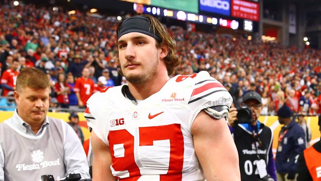 Ohio State Buckeyes defensive lineman Joey Bosa (97) leaves the field after being ejected for targeting in the first quarter against the Notre Dame Fighting Irish during the 2016 Fiesta Bowl at University of Phoenix Stadium.