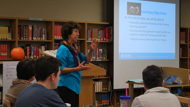Laura Arndt, consultant from McREL International, spoke to Marian teachers about inquiry based learning at an Election Day professional development workshop.