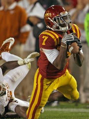 des.s1002isufb  -  PHOTO BY BILL NEIBERGALL/DES MOINES REGISTER,  AMES  OCT. 1ST  -   Iowa State's #7 Darius Reynolds, right, fell to the turf with what looked to be a catch after he was grabbed and tackled by Texas' #31 Leroy Scott, left, as the pass was ruled incomplete but pass interfence was called on the play in second half action of football game played at  Jack Trice Stadium in Ames on Saturday night Oct. 1st , 2011.     (shot: 10/01/11)  Photo by BILL NEIBERGALL