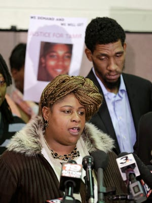 Samaria Rice, mother of Tamir Rice, the 12-year-old boy fatally shot by a Cleveland police officer, speaks during a news conference Dec. 8 as Tamir's father, Leonard Warner, listens. The Cuyahoga County Medical Examiner's office has released the results of Tamir's autopsy.